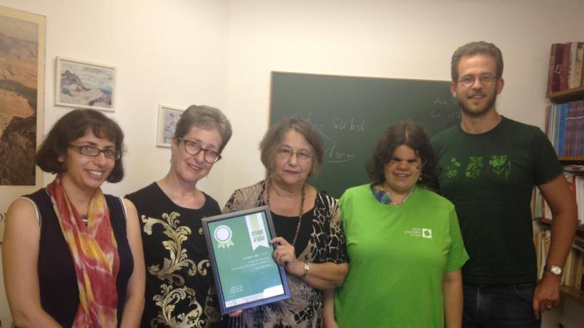 Receiving the Teaching Excellence Certificate from Students with disabilities, August 2016